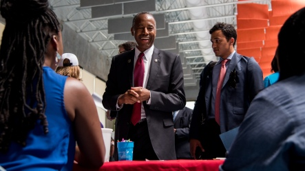 Dr. Ben Carson, the United States Secretary of Housing and Urban Development, speaks with Melissa Parris and Carla Neal of St. Vincent de Paul Head Start at the annual Health Homes Community Fair. Secretary Carson visited Baltimore on Thursday, June 29, 2017 as part of a 'listening tour' around the country.