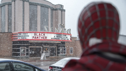A Spider-Man statue stands outside of the Amazing Spiral comic shop, across the street from The Senator Theatre where people packed in to catch a showing of Black Panther during its opening weekend.