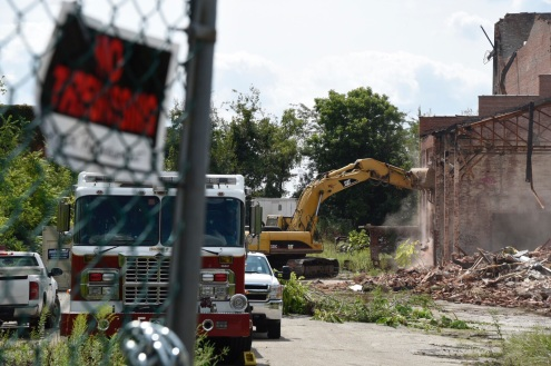 A bulldozer works on tearing down the former Seagram's plan in Dundalk.