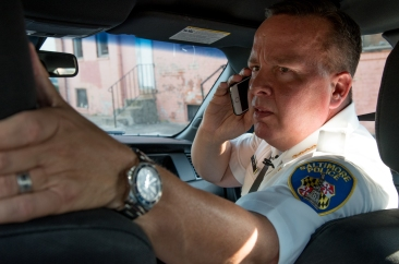 Police Commissioner Kevin Davis speaks on the phone inside his car near the 900 block of Bennett Place. Part of Dan Rodricks' ride-along with Davis on Thursday, August 24, 2017.