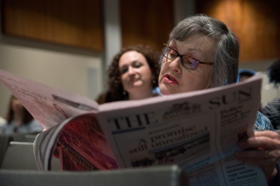 Jean Suda, of Baltimore County, reads part two of 'Bridging the Divide' before the forum to discuss the series begins. The Baltimore Sun co-hosted a panel at Loyola University Maryland Wednesday, March 29, to further the discussion about fighting segregation in local schools.