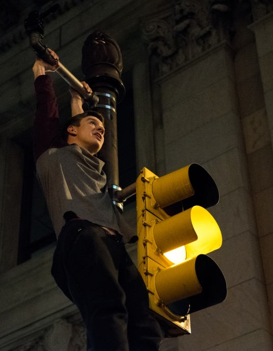 Philadelphia,PA-2/4/18-One Eagles fan swings from the top of a street light on Broad St. Thousands of people celebrated in the streets of Philadelphia after the Eagles beat the Patriots in Super Bowl LII.